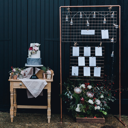Copper frame table plan backdrop