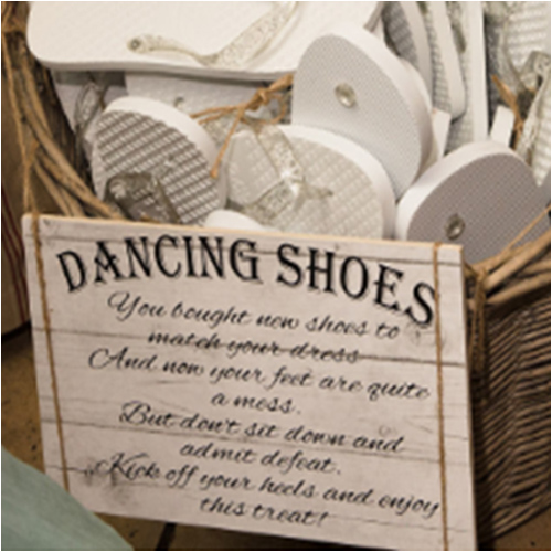 Wooden dancing shoes flip flop sign