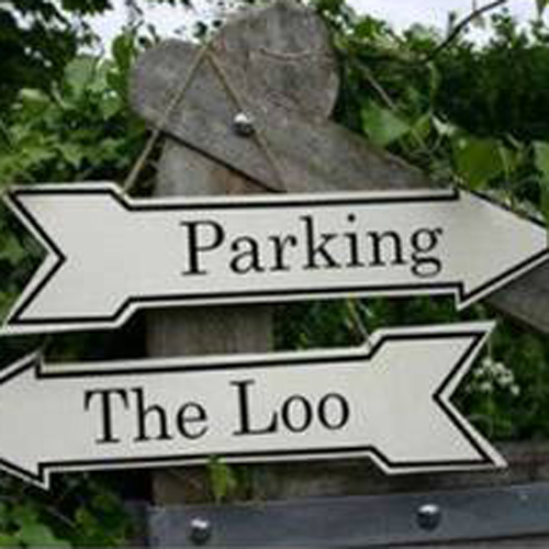 Metal enamel parking the loo outdoor arrow sign