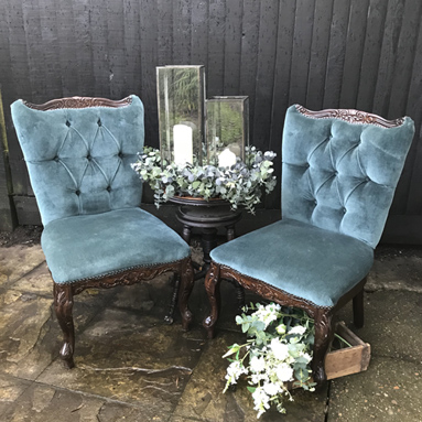 Teal velvet chairs chillout area