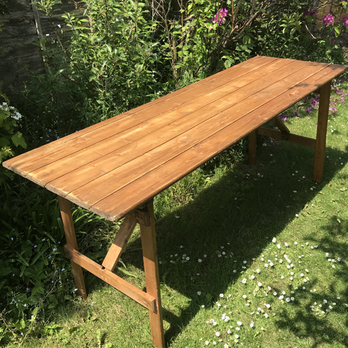 Rustic wooden vintage trestle table